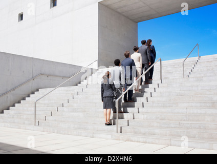 Business people standing in a row on urban stairs - Stock Photo