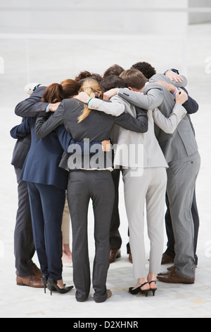 Business people in huddle - Stock Photo