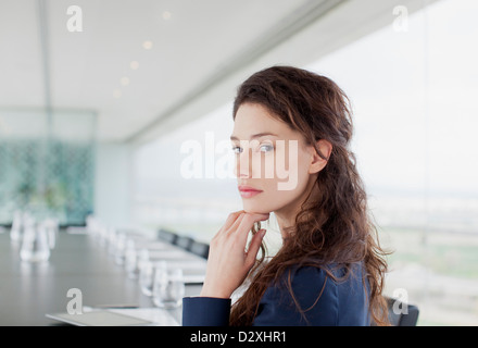 Portrait of serious businesswoman in conference room - Stock Photo