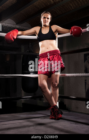 Female kick boxer in the ring - Stock Photo