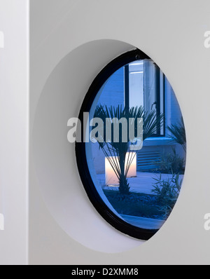 Pollen House, London, United Kingdom. Architect: Ben Adams Architects, 2013. Interior View through porthole window - Stock Photo