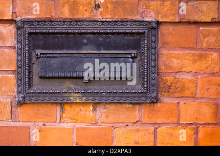 Old mailbox in Post-Office Building in Czluchow - Stock Photo