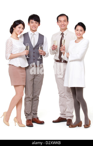 Wealthy family having champagne - Stock Photo