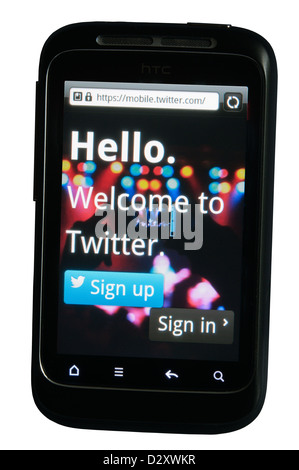 Twitter social networking and messaging app displayed on a mobile phone. - Stock Photo