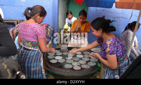 street leading cemetery women females making tortilas day dead latin america central economy trade food tribal - Stock Photo