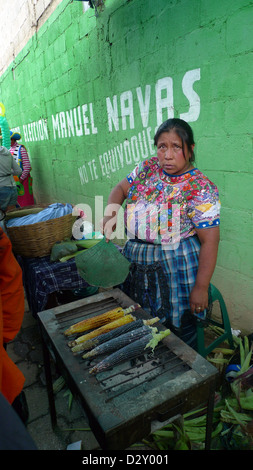 street leading cemetery woman female rasting corn day dead latin america central food tribal indigenous mayan - Stock Photo