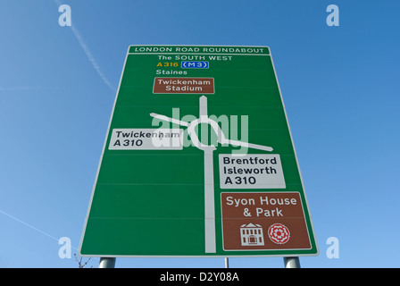 british road sign giving directions from a roundabout in southwest london, england - Stock Photo