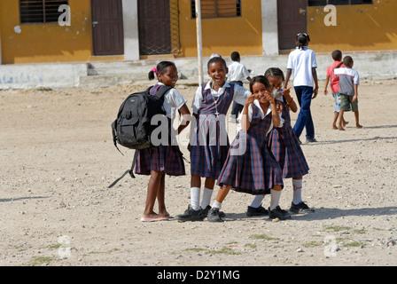 Colombia, Tierrabomba, portrait of schoolgirls standing together and gesturing - Stock Photo