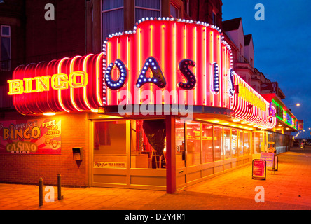 neon signs for an amusement arcade and bingo hall at night Skegness Lincolnshire England UK GB EU Europe - Stock Photo