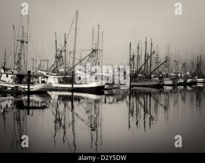 Fishing boats with fog at Newport Harbor. Oregon - Stock Photo