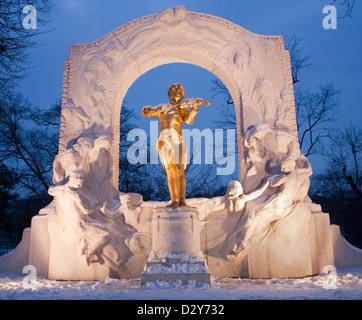 Johan Strauss memorial from Vienna Stadtpark in winter dusk - Stock Photo