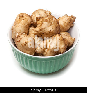Bowl of Jerusalem Artichoke's (Helianthus tuberosus) vegetable isolated on a white studio background. - Stock Photo