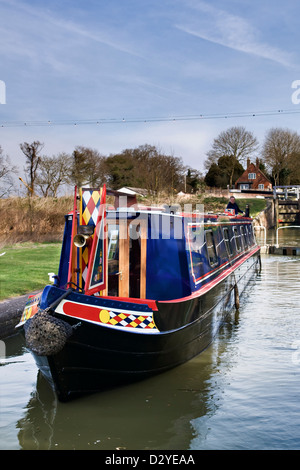Newly painted canal boat on the Kennet and Avon canal at Caen hill locks Devizes in Spring - Stock Photo