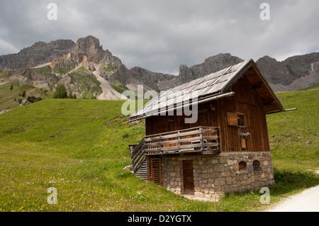 Typical mountain hut, typical historical mountain house, Marmolada on the background, Località Fuchiade, Soraga, - Stock Photo
