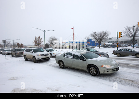 cars in traffic jam travelling along 8th street Saskatoon Saskatchewan Canada - Stock Photo