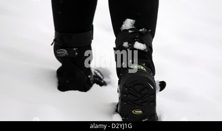 Walking in Snow Wearing NEOS Overshoes - Stock Photo