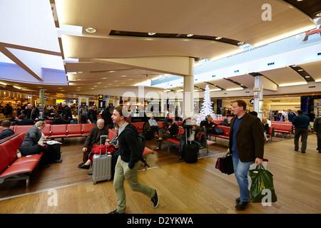 passengers in departure terminal 3 of Heathrow Airport London UK - Stock Photo