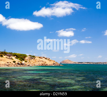 View across clear water to Granite Island, South Australia - Stock Photo