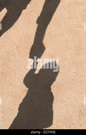 Father playing with son shadow. India - Stock Photo