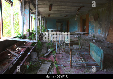 Chernobyl disaster results. Abandoned school. - Stock Photo