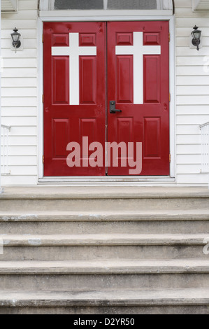Church doors with large white crosses and steps leading to the entrance, classic small house of worship in the American - Stock Photo