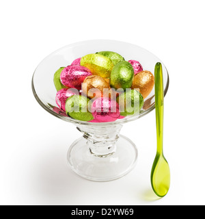 Ice cream sundae with colorful chocolate candy Easter eggs wrapped in foil clipping path included - Stock Photo
