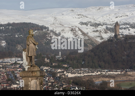 Outside Stirling Castle stands the statue of Robert The Bruce, overlooking Stirling, with William Wallace monument in distance.
