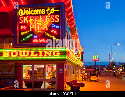 neon signs for bowling, amusements and Skegness Pier at the seafront Lincolnshire England UK GB EU Europe - Stock Photo