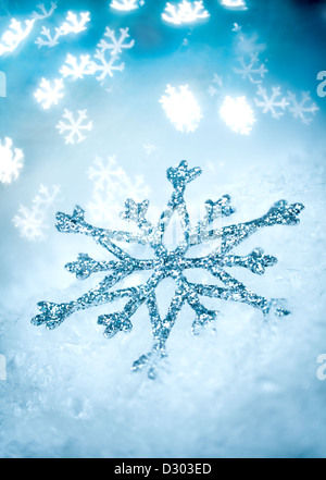 Snowflake on a Blue Holiday background ... - Stock Photo
