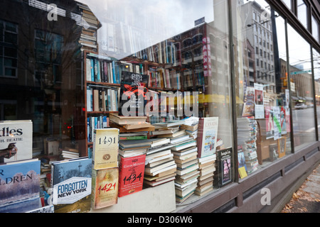 books in the window of a used book store Vancouver BC Canada - Stock Photo