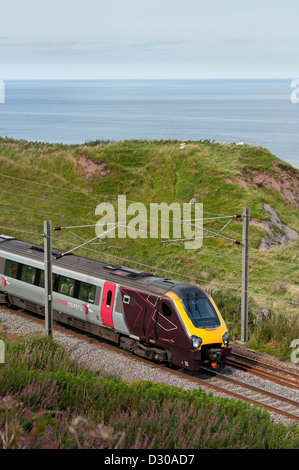 High speed Crosscountry Voyager train on the East Coast Main Line running alongside the coast in the North of England. - Stock Photo