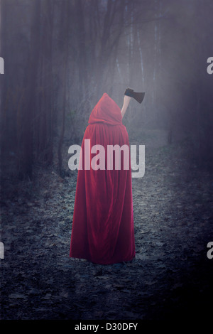 a woman in a red cloak with an axe