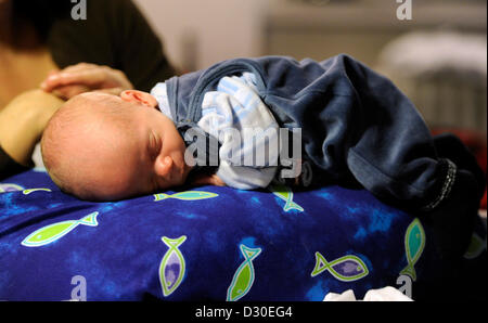 3 month old baby boy with 15 year old teenage brother held interested stock photo royalty free. Black Bedroom Furniture Sets. Home Design Ideas