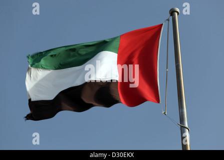 Dubai, United Arab Emirates, national flag waving in the wind - Stock Photo