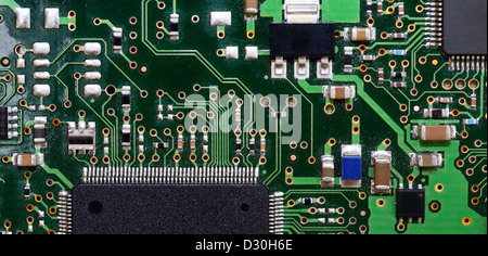 Macro background shot of old green motherboard. - Stock Photo