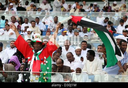Dubai, United Arab Emirates, locals waving the national flag - Stock Photo