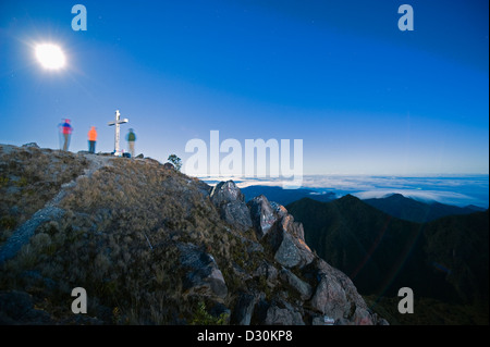 tourists waiting for sunrise on the summit of Volcan Baru, (3478m), highest point in Panama, Volcan Baru National - Stock Photo