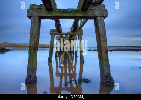 Disused Pier at dusk, CastleRock, Londonderry. - Stock Photo