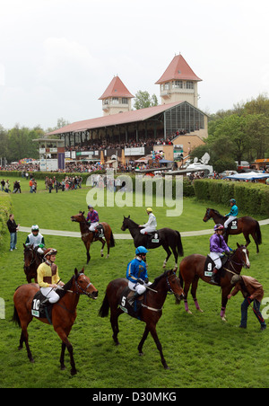 Leipzig, Germany, horses and jockeys in front of the grandstand the racecourse - Stock Photo