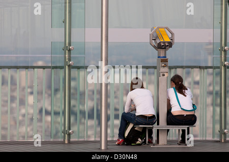 two woman enjoy the view of Paris from Tower Montparnasse - Stock Photo