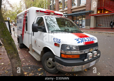 emergency paramedic ambulance parked on the side of a street in downtown Vancouver BC Canada - Stock Photo