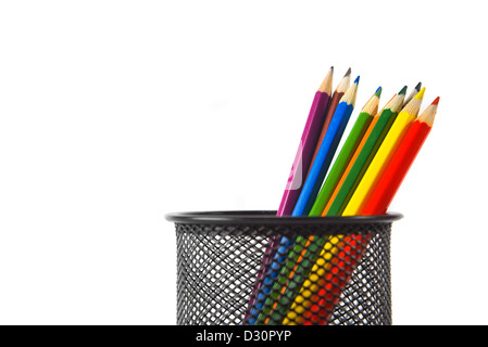 Wood color pencils in black metal pencil holder over a white background - Stock Photo