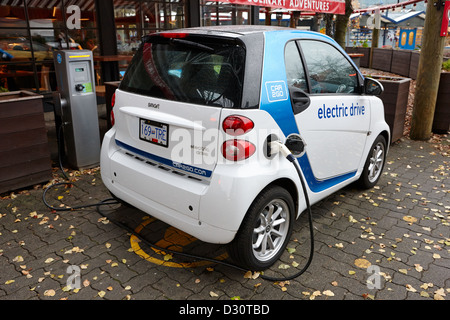 car sharing car2go electric car charging at a parking spot in Vancouver BC Canada - Stock Photo