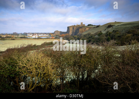 View of the The Old Church of St Nicholas at Uphill on a prominent cliff-top with rolling hills down to field in - Stock Photo