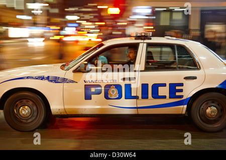 Vancouver police squad patrol car vehicle BC Canada deliberate motion blur - Stock Photo