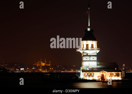 ISTANBUL TURKEY - Maiden's tower floodlit at night sits on islet off the coast of Uskudar, Bosphorus strait, Istanbul - Stock Photo