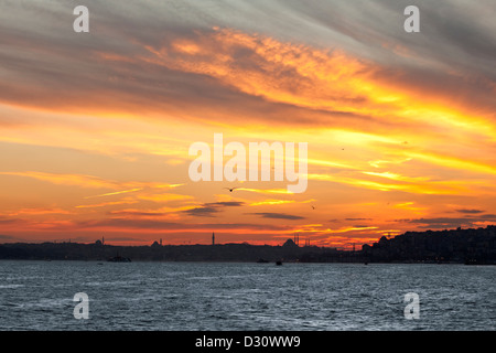 Eminonu District, Suleymaniye mosque, Beyazit tower and Hagia Sophia viewed at sunset from Bosphorus strait,  Istanbul - Stock Photo