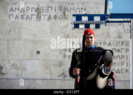 Guard (Evzone) marching in front of the Tomb of the Unknown Soldier, Athens, Greece. - Stock Photo