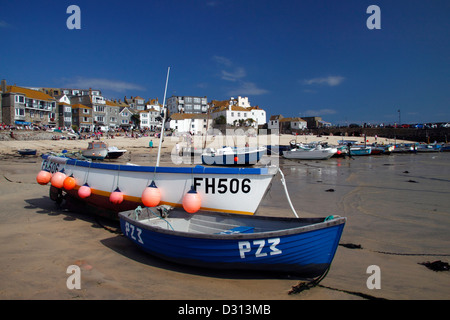 Blue fishing boats in St Ives harbour - Stock Photo