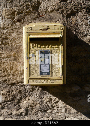 A French wall-mounted mailbox - Stock Photo